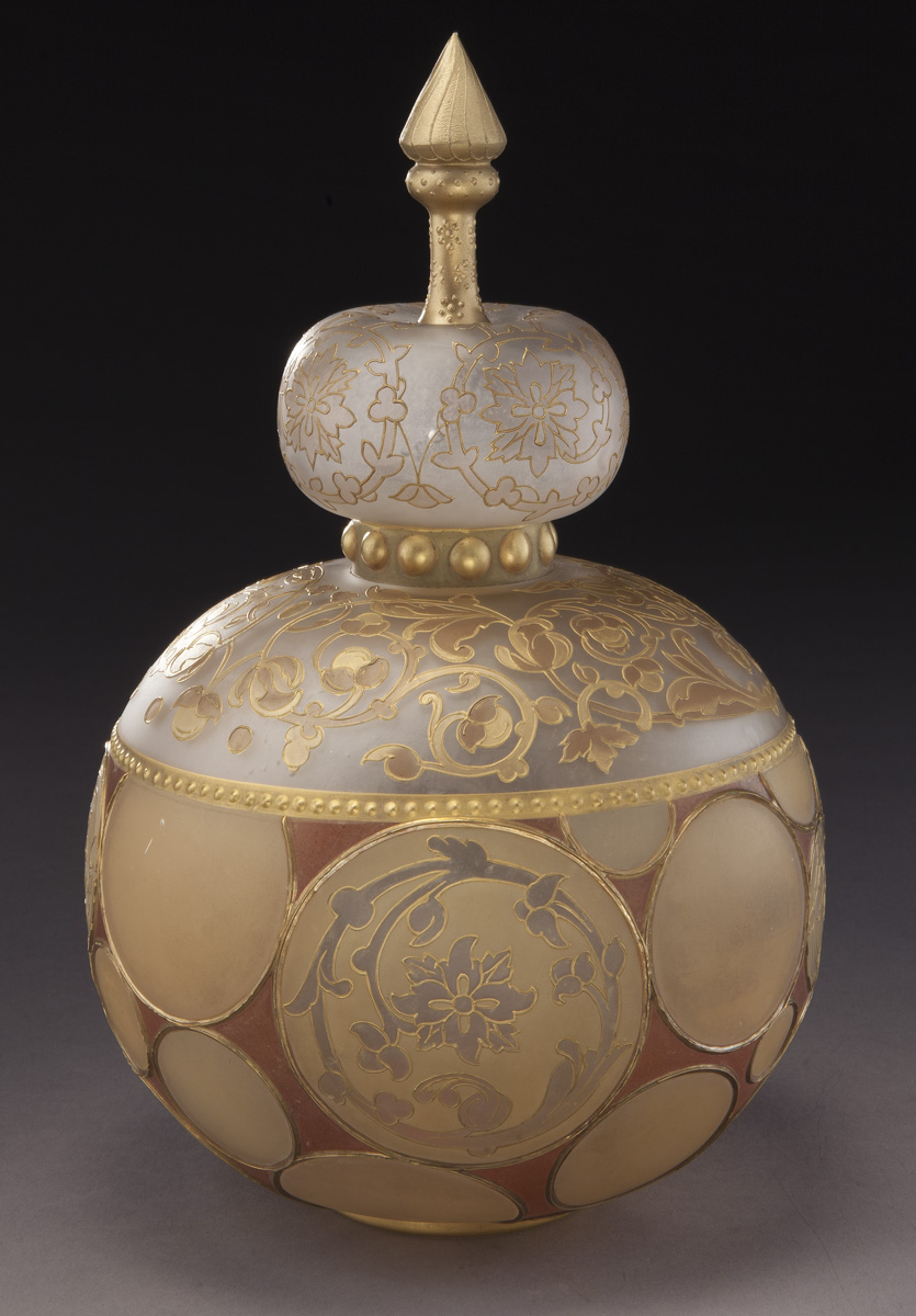"Mt. Washington Royal Flemish covered jar decorated with circular medallions and fitted with a crown finial. 11.5"" H, Est. - $3,000 - $6,000"