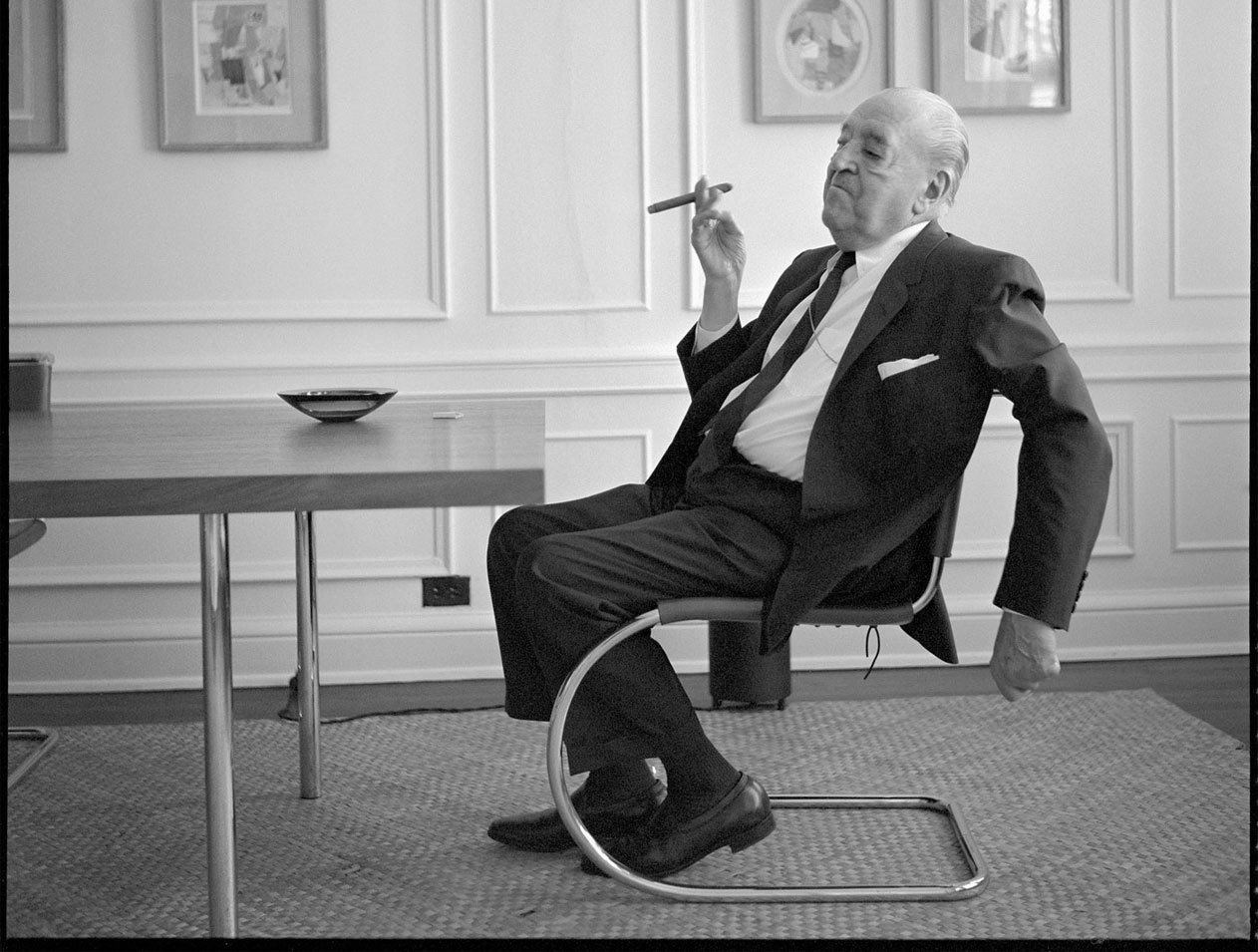 Mies van der Rohe in the Mr Side Chair he designed. Photo: Mies Society