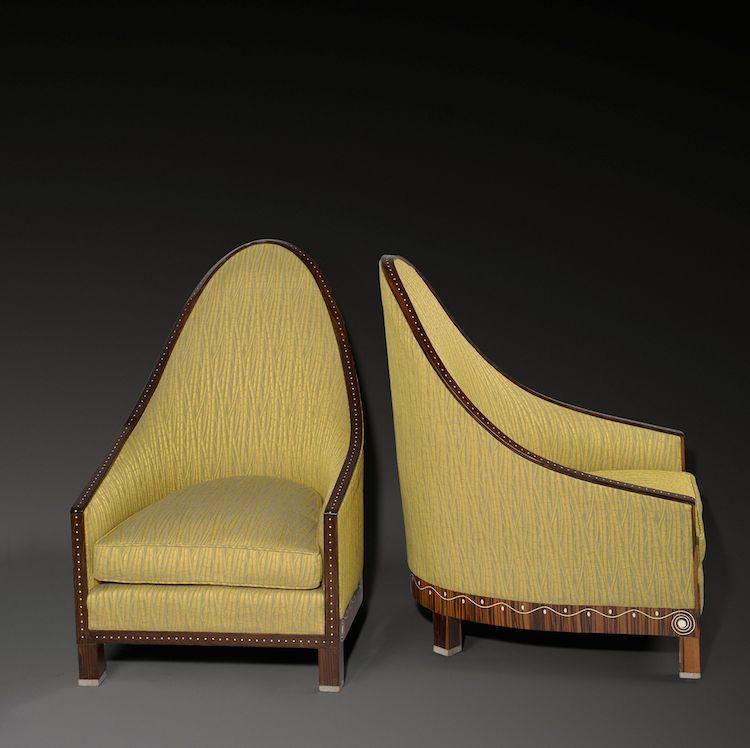 "Jacques-Émile Ruhlmann. Pair of cathedral armchairs, model ""Doucet"". 1913 Makassar, ebony, ivory, silver chrome-plated feet.  Precio mínimo estimado: 200 000 EUR Grisebach"
