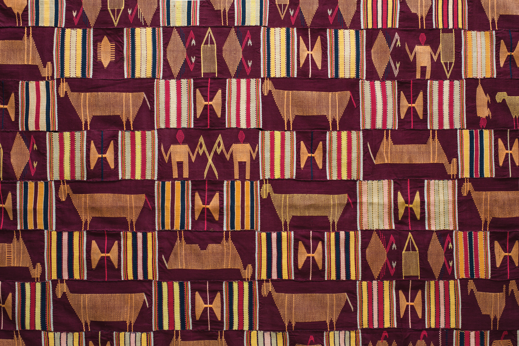 Man's Cloth, Ewe People, Eastern Ghana or Southwest Togo, cotton, mid 20th century. Woven in narrow strips and then sewn together, Karun Collection. Photo courtesy HALI