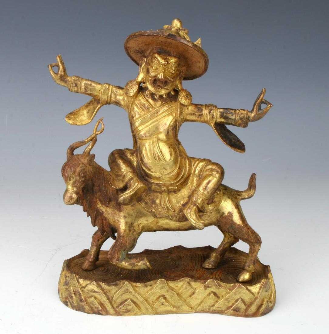 Antique bronze depicting a Vajrapani wearing a hat and riding a spiral-horned goat, with the stand representing mountains, 6 inches by 7 inches (est. $1,500-$2,500).
