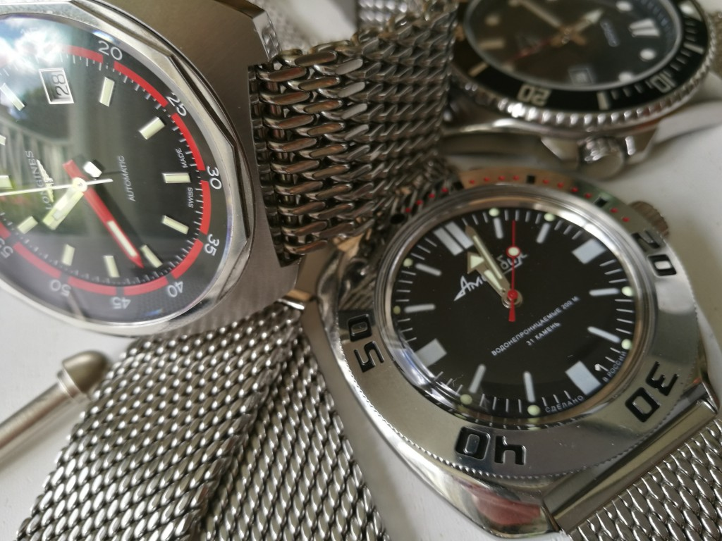 Longines Heritage Diver, Vostok Amphibia and a resting Casio MDV106 all meshed up!