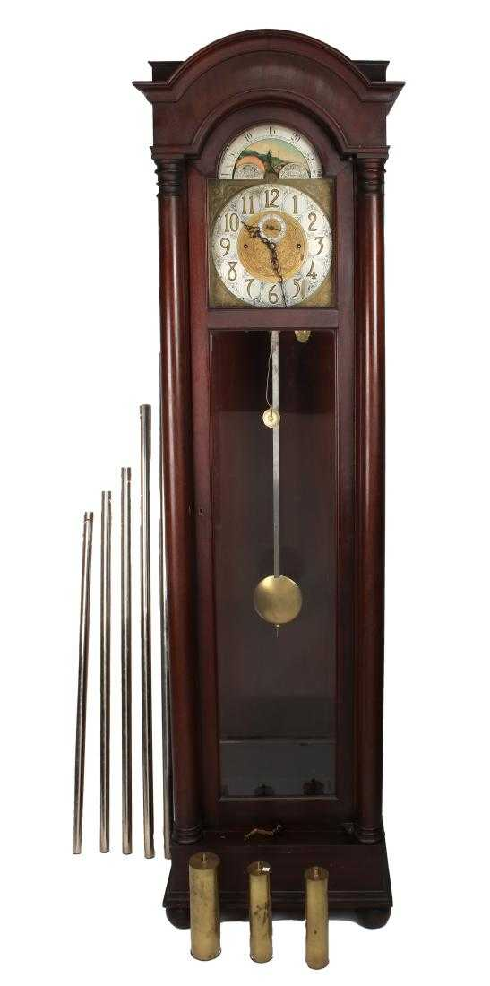 Five-tube, quarter-chime hour, mahogany strike hall clock made by Colonial Mfg. Co. (Zealand, Mich.), flanked by two columns with an arched top, 92 ½ inches tall (est. $1,500-$2,500).