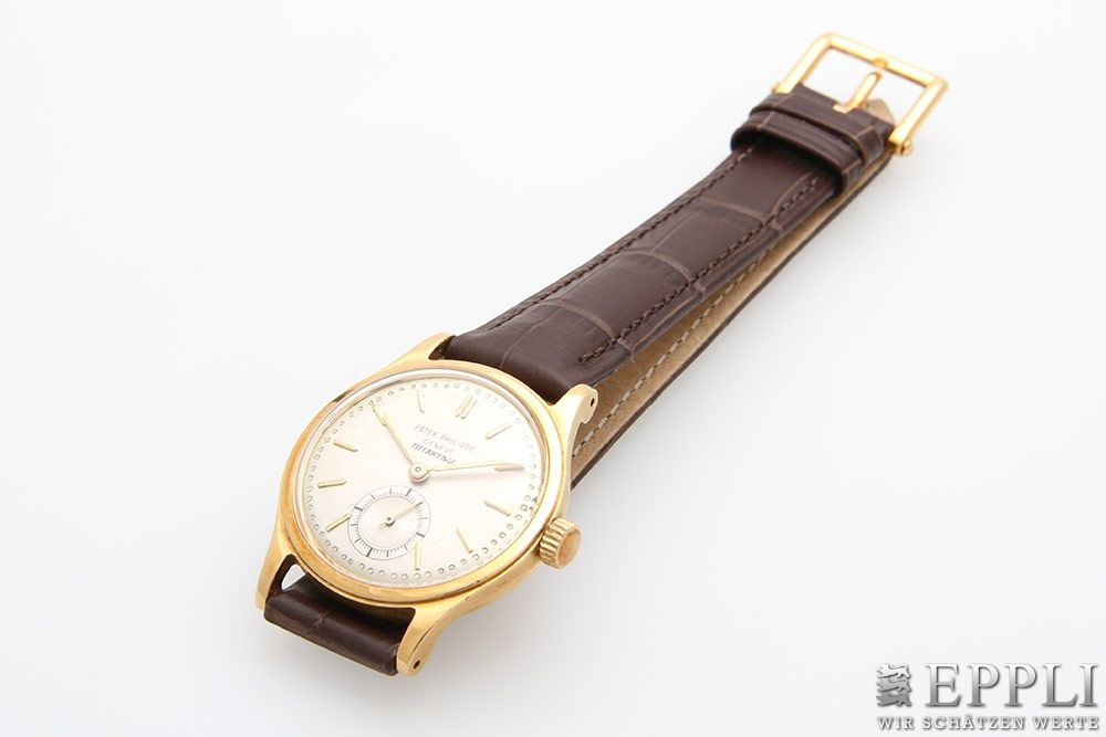 "PATEK PHILIPPE & TIFFANY & CO. - Herrenarmbanduhr ""Calatrava"" aus Gelbgold mit Handaufzug, 1950er Jahre Aufrufpreis: 9.600 EUR"