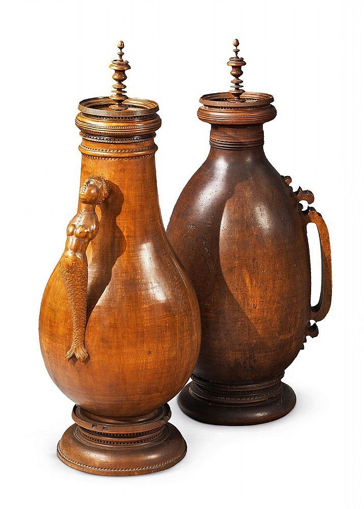 Two important lathed walnut cans, one pot with figural handle (mermaid), H:. 93 and 90.5 cm, Southern Germany / Alpine 17th century Estimate: 60 000-80 000 EUR