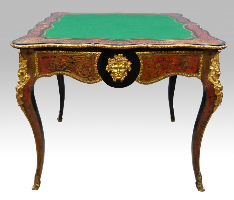 A 19th century French Boulle folding card table had a final price of £1,905. It had a serpentine front with gilt metal mounts on cabriole legs
