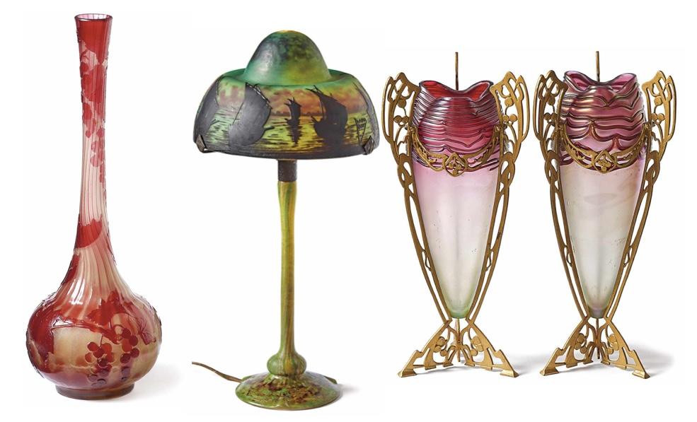 Links: EMILE GALLÉ - Langhalsvase mit Johannisbeeren, H: 40 cm, bezeichnet, Nancy um 1900/05 Schätzpreis: 1.500 EUR Mitte: DAUM FRÈRES - Tischlampe aus Glas, elektrifiziert, H: 46 cm, Nancy um 1920 Schätzpreis: 1.200 EUR Rechts: JOHANN LOETZ WITWE - Paar Ziervasen in Messingmontierung, H: 34,5 cm, Klostermühle um 1910 Schätzpreis: 1.400 EUR