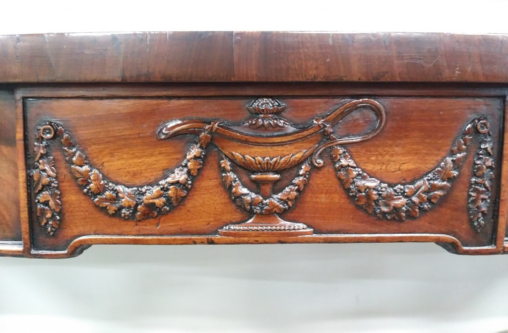 An antique George III mahogany serving table