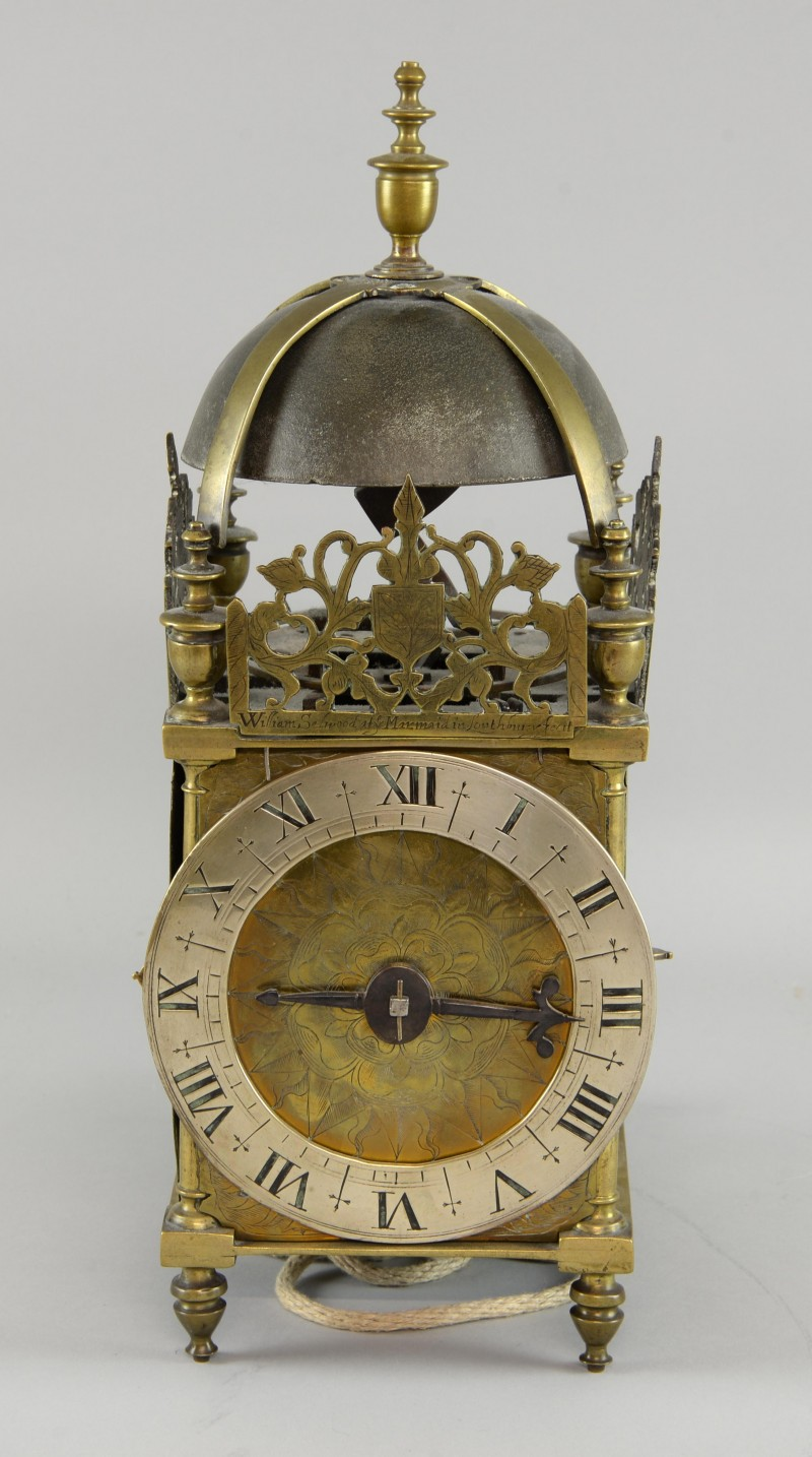 A rare mid-17th century English brass lantern clock, saw a battle of three phone bidders, going against multiple bidders online and in the room. It had a final price of £16,510