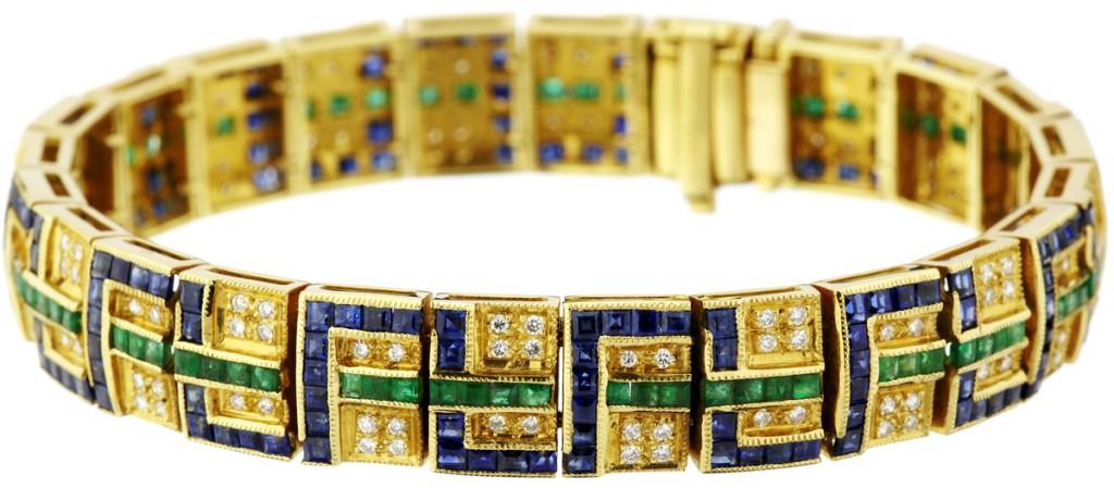Armband aus GG mit Brillanten (ca. 0,79 ct), Saphiren und Smaragden (11,29 ct)