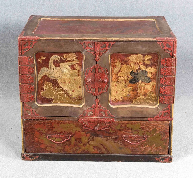 Chinese Cabinet ca. 1920, all sides decorated with culture specific paintings, two doors and one drawer, interior includes 7 drawers behind the front doors, black lacquered drawers with decorated with a floral motif, slight wear and tear, 70 x 75 x 40 cm. Estimate: $570