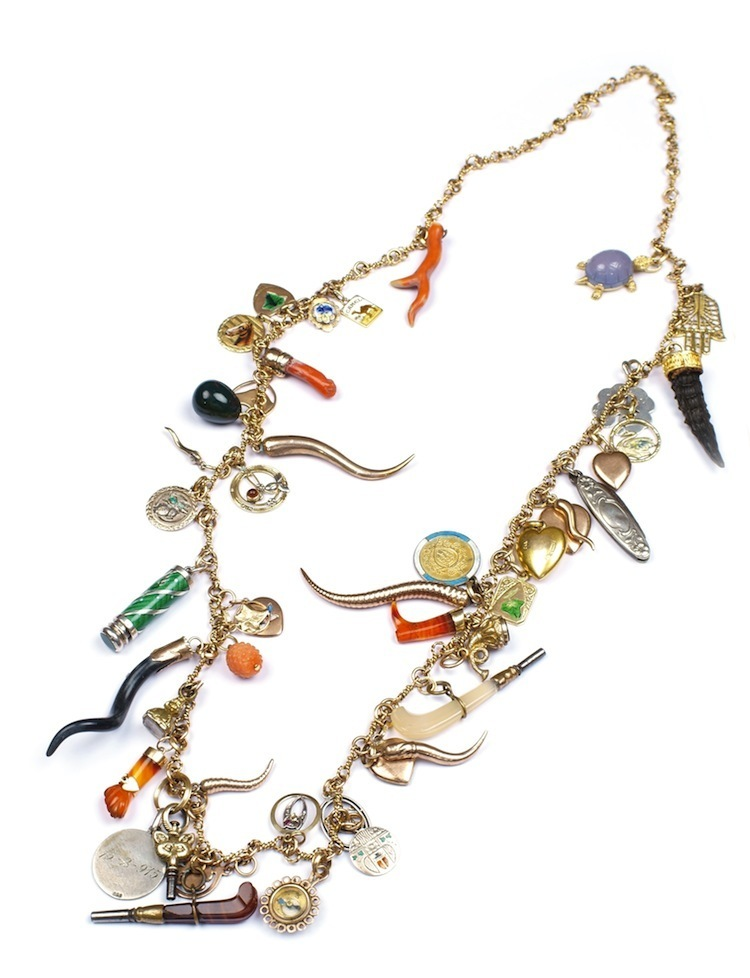 A gold necklace with 46 different pendants, made in England during the 1800's has an estimate of $2,700- $3,300.