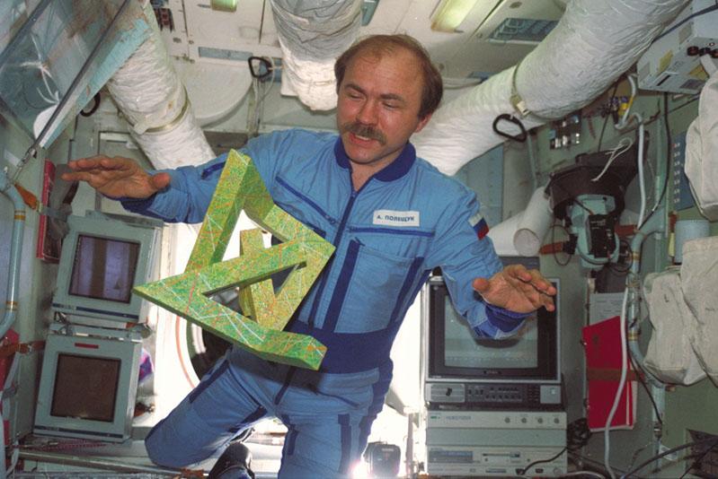 """Cosmonaut Alexander Polischuk in zero gravity with """"Cosmic Dancer"""", image via Cosmicdancer.com"""