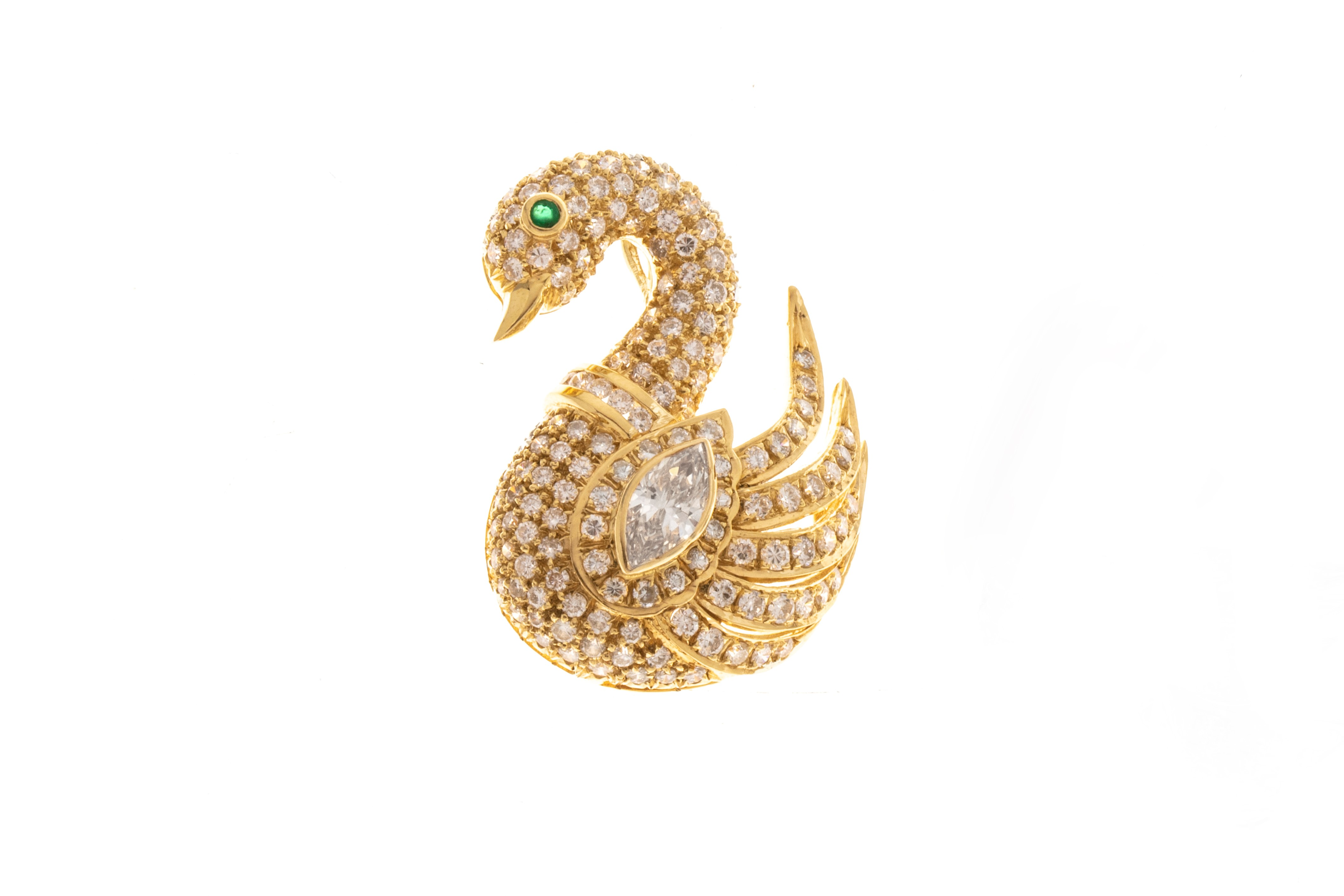 Diamond and 18K white gold swan form pendant-brooch (est. $700-$900).