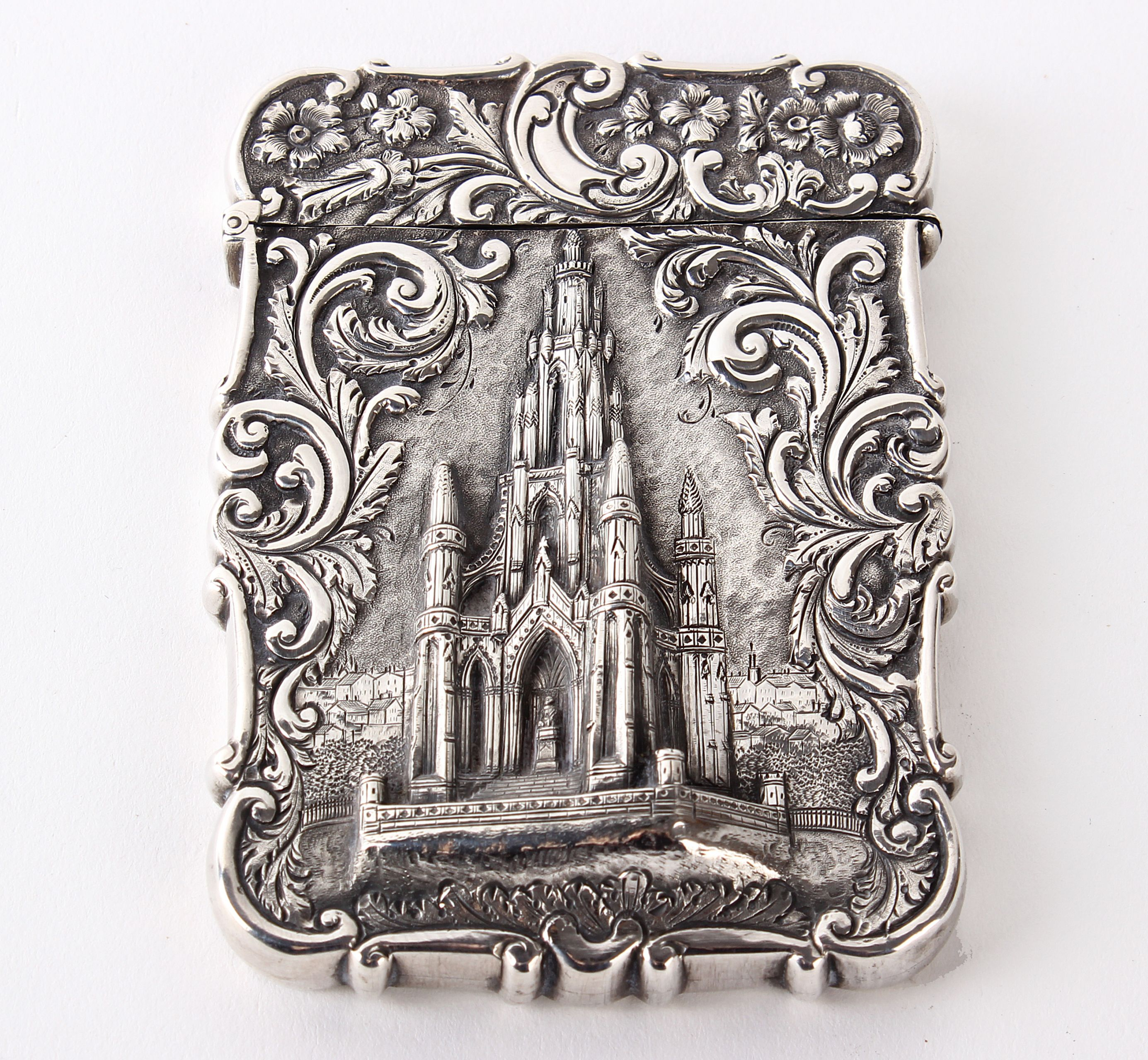 A Victorian silver Castle Top card case depicting The Scott Memorial Edinburgh, by Nathaniel Mills Birmingham 1846 inscription to back. 10 cm x 7 cm , 2.2 toz or 71 grams. Bristol Auction Rooms Estimate:£300 - £400
