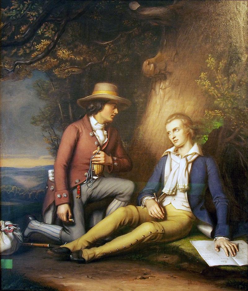 """Schiller auf der Flucht aus Württemberg mit seinem Freund Andreas Streicher. Gemälde von Max Stieler (1825-97). Schiller ist in """"Werther-Tracht"""" dargestellt: Goethes Titelheld aus """"Die Leiden des jungen Werthers"""" trug eine blaue Jacke und gelbe Hosen, ein """"Outfit"""", das von der begeisterten jungen Leserschaft aufgegriffen wurde und zu einem Erkennungszeichen des Sturm und Drang wurde."""