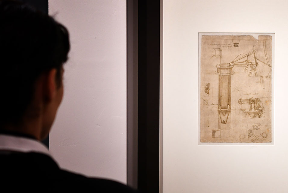 "Leonardo da Vinci's ""Study for a hydraulic pump, man with a perspectograph (Codex Atlanticus)"" at""Science Before Science"" Scuderie del Quirinale palace in Rome. Image: Alberto PIZZOLI / AFP."