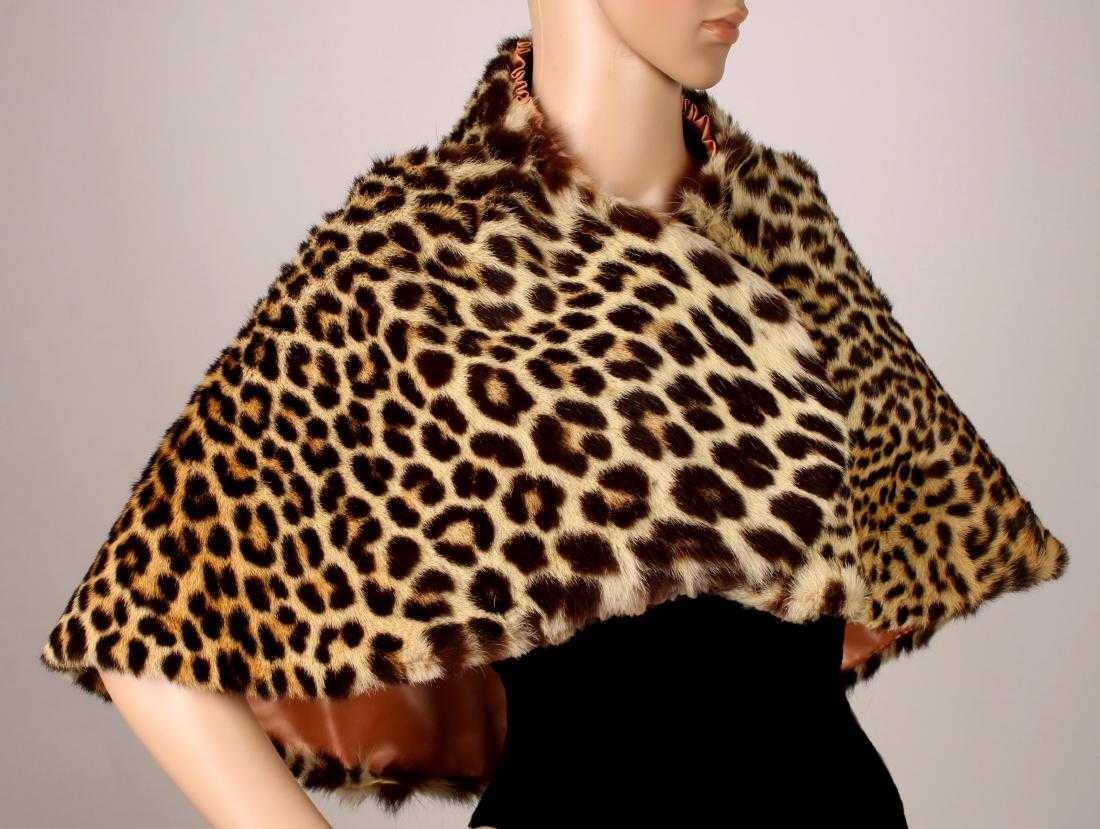 Genuine leopard fur bolero short cape stole from circa 1950 with a peach satin lining and two hook closures, in near perfect condition with supple fur (est. $600-$1,000).