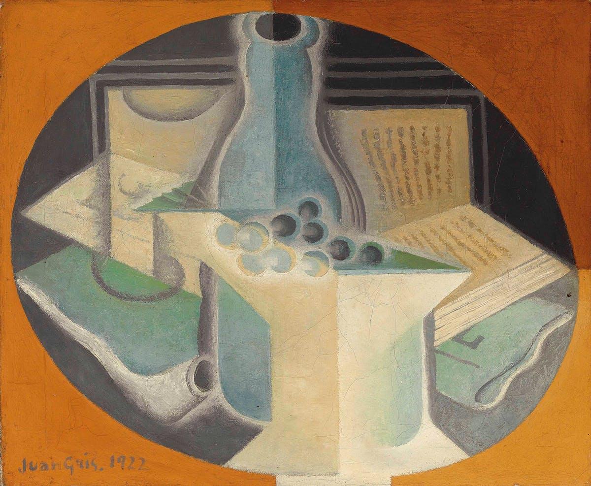 JUAN GRIS. Raisins, carafe et livre (1923). Imagen vía: Christie's