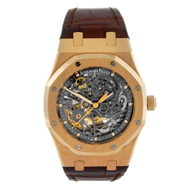 CURRENT MODEL: AUDEMARS PIGUET - a gentleman's Royal Oak Openworked wrist watch. 18ct rose gold case with exhibition case back. Reference 15305OR.00.D088CR.01, serial H87511. Numbered 317. Signed skeletonised automatic calibre 3129. Anthracite chapter ring with rose metal hour markers. Fitted to a signed brown alligator strap with 18ct rose gold deployant clasp. 39mm. Estimate: £12 000-18 000