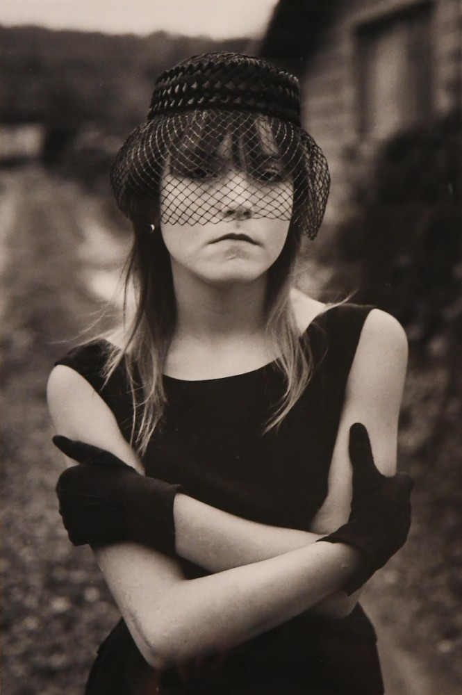 Gelatin silver print by Mary Ellen Mark (American, b. 1940), titled Streetwise, Tiny in Her Halloween Costume (Seattle, Wash., 1983), printed later (est. $1,000-$2,000).