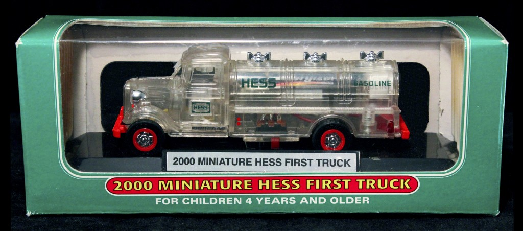 Three Hess toy trucks