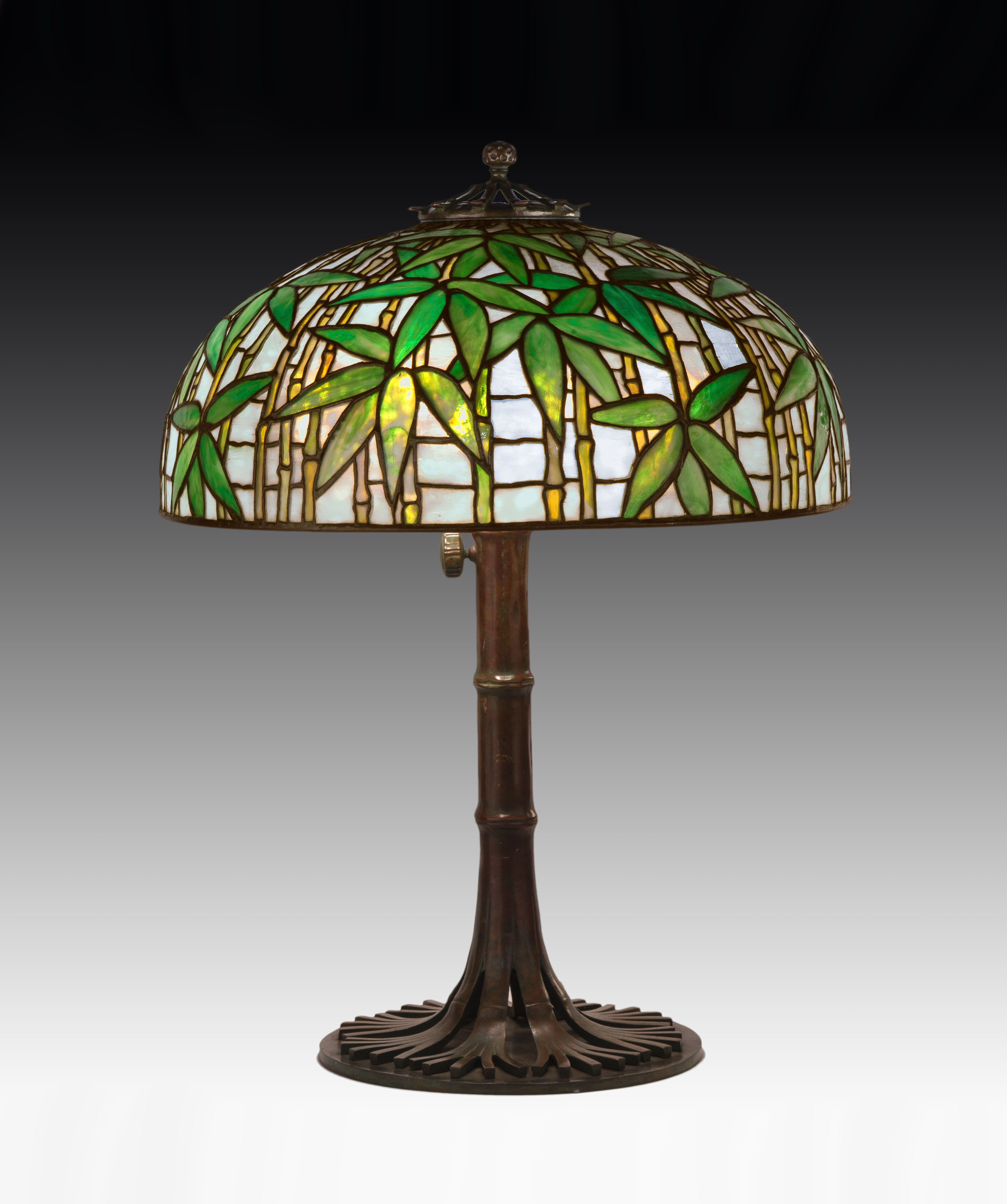 Several beautiful Tiffany Studios (N.Y.) lamps illuminated the room before finding new buyers. They included this gorgeous Bamboo table lamp ($85,500).