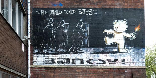 Banksy, véritable icône de la ville de Bristol, à l'ouest de l'Angleterre Barry Lewis/Corbis/Getty Images