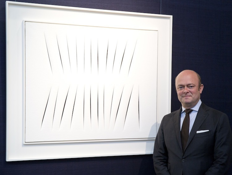 Sotheby's CEO of Scandinavia, Peder Isacson, in front of The Concetto Spaciale, Attese, which sold at Sotheby's for £8.4 million Image via Sotheby's