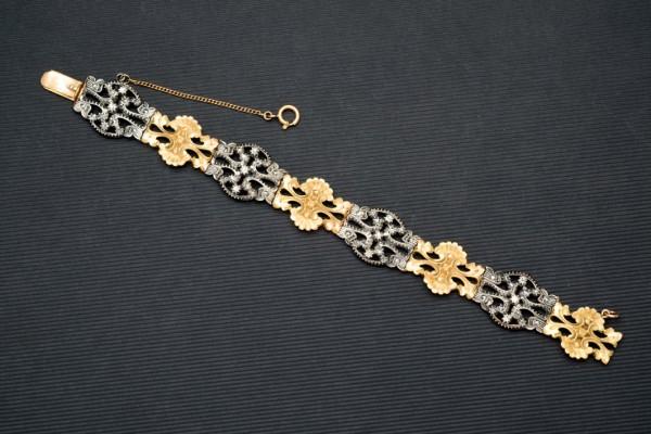 Armband aus GG und Silber mit floralen Elementen und Diamanten