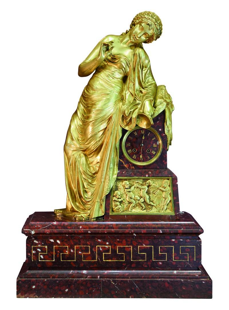 Reloj de sobremesa en bronce y mármol rojo veteado. París (siglo XIX)
