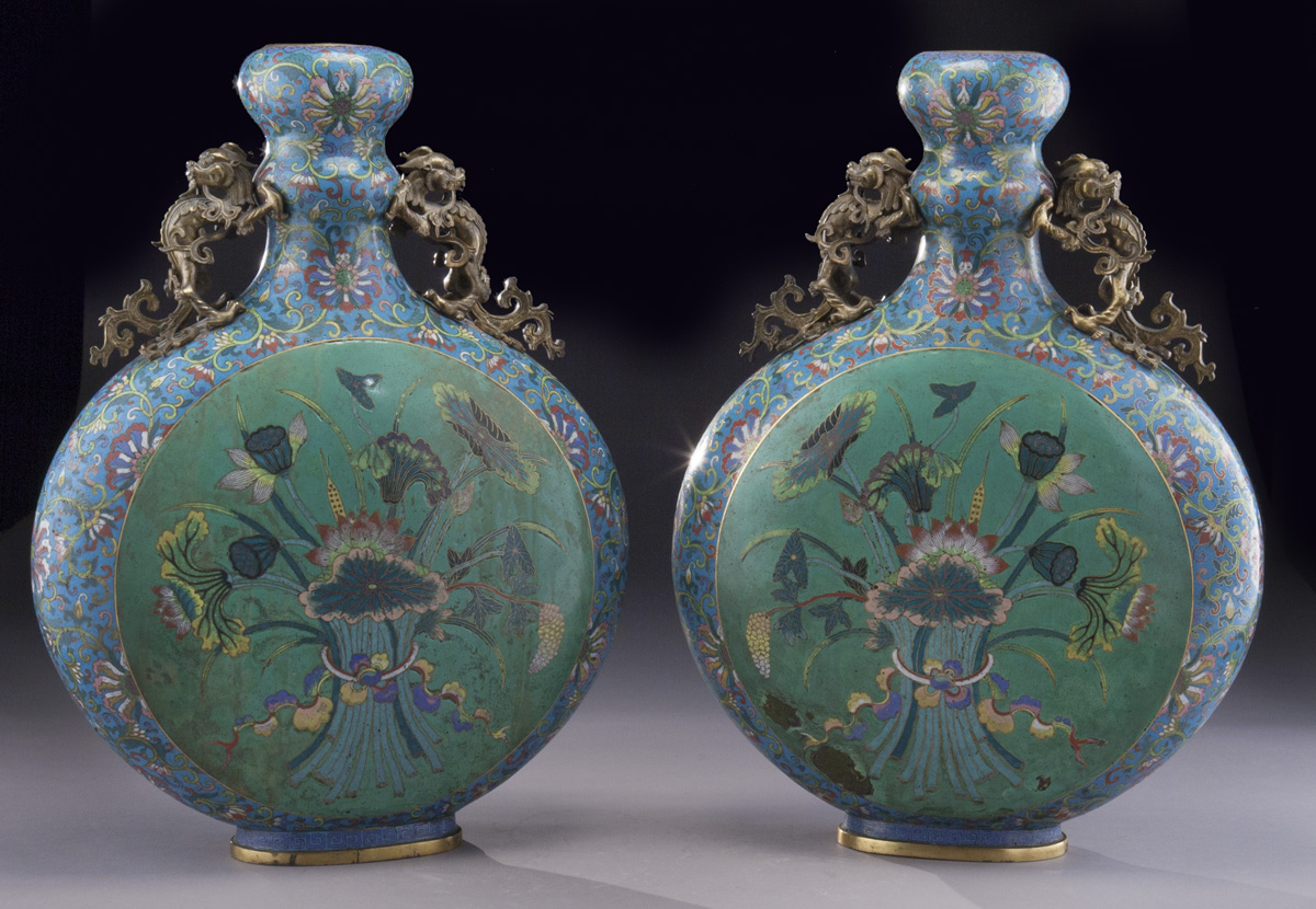 "Pair of Chinese Qing cloisonné moon flasks decorated with lotus flowers and other aquatic plants plus intricately cast gilt bronze handles, circa 1800. 21.5""H, est. - $2,000 - $3,000"