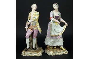 A pair of Meissen porcelain figurines.