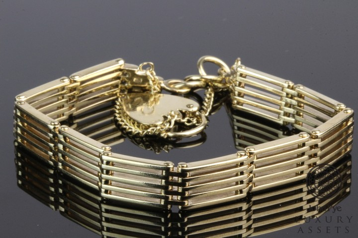 A 9ct Gold Gate-link Bracelet with Heart-shaped Padlock Clasp. Photo: John Pye Auctions