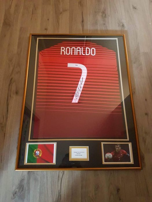 Signed and framed national team jersey by CRISTIANO RONALDO, 2015, with certificate