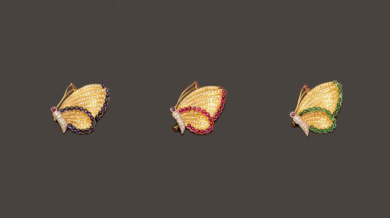 Schmetterlingsbroschen aus GG mit Diamanten und Saphiren, Rubinen oder Smaragden