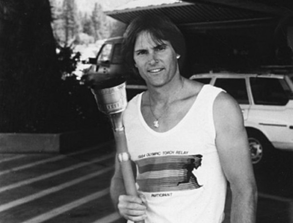Jenner carrying Olympic torch in 1984 Image via Heritage