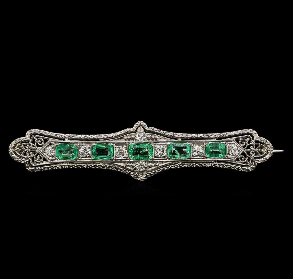Brosche aus Weißgold mit Smaragden (1,30 ct) und Diamanten