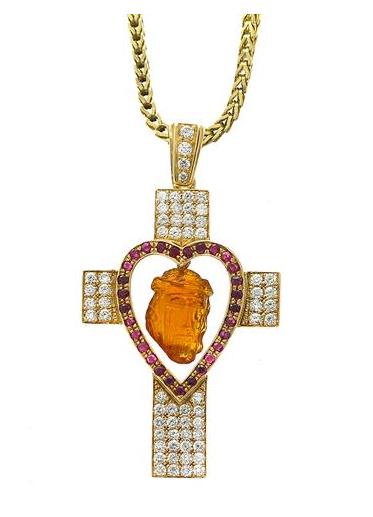 Hänge i 18K guld med briljantslipade diamanter, rubiner och snidad citrin med kristusmotiv.