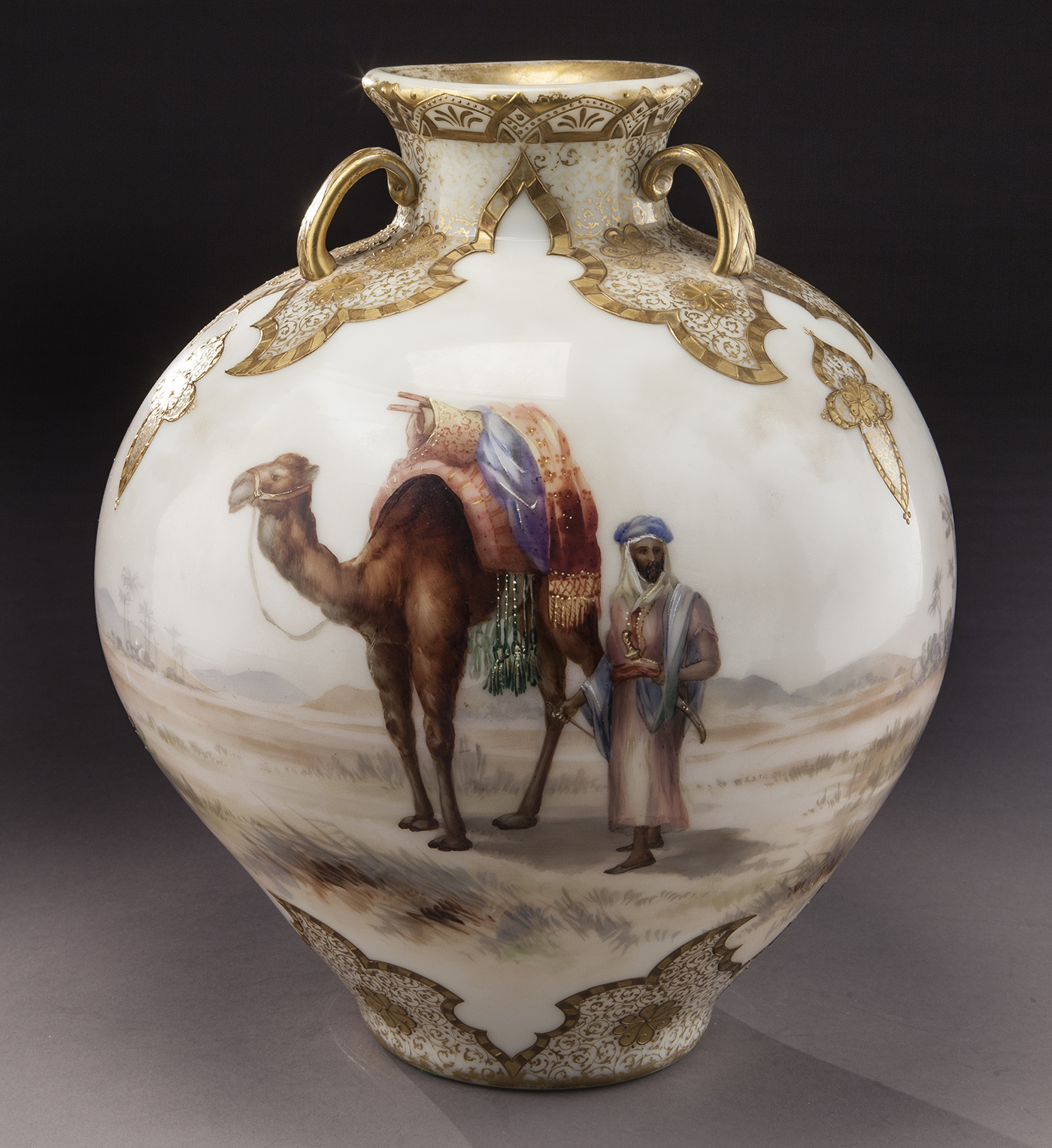 """Mt. Washington Colonial ware Garden of Allah glass vase, large ovoid form decorated with Egyptian scene of camels Bedouin. NOTE: Mt. Washington & Pairpoint Glass by Wilson, page 95. 12.5""""H, Circa - 1890."""
