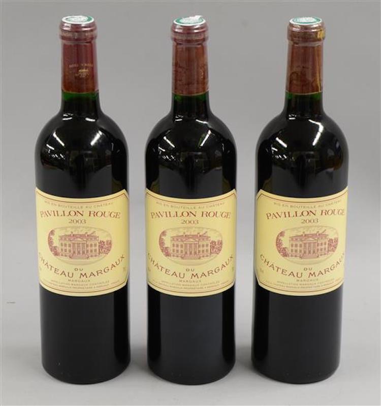 3 bottles of 2003 Pavillion Rouge Bordeaux red wine . Estimate $390 - $550. Photo via Ewbank's