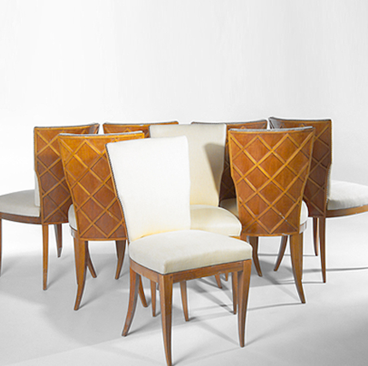 Eight dining side chairs with applied latticework, sold for $48,000
