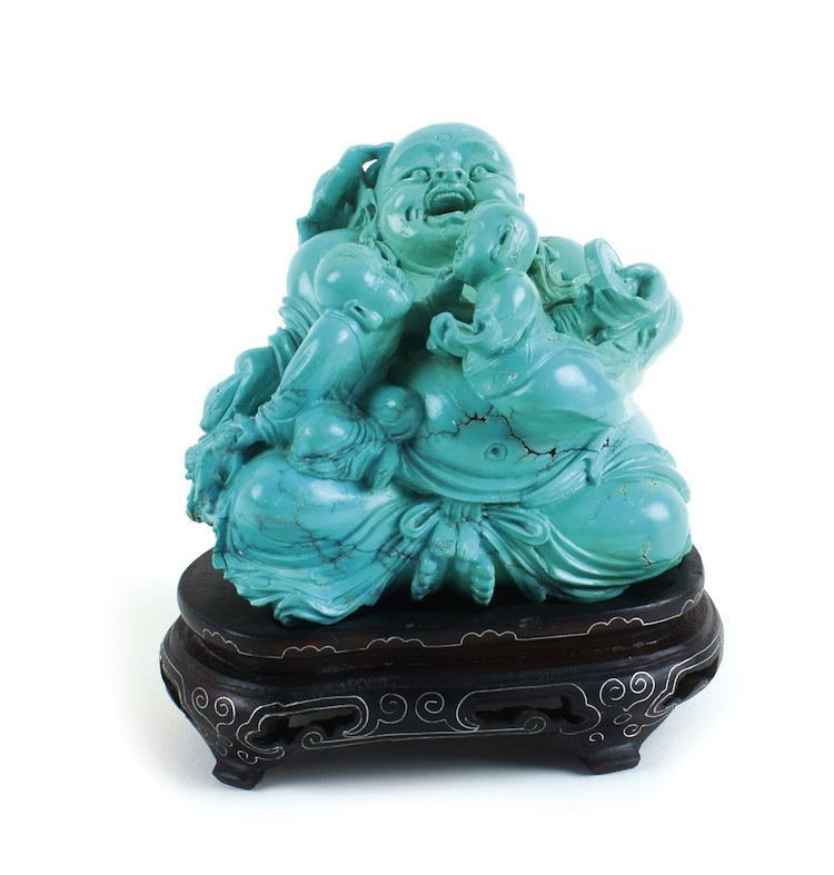 This wonderful Chinese figurine from the 1900's on a wood pedestal has an estimate of $1,300-$1,500.