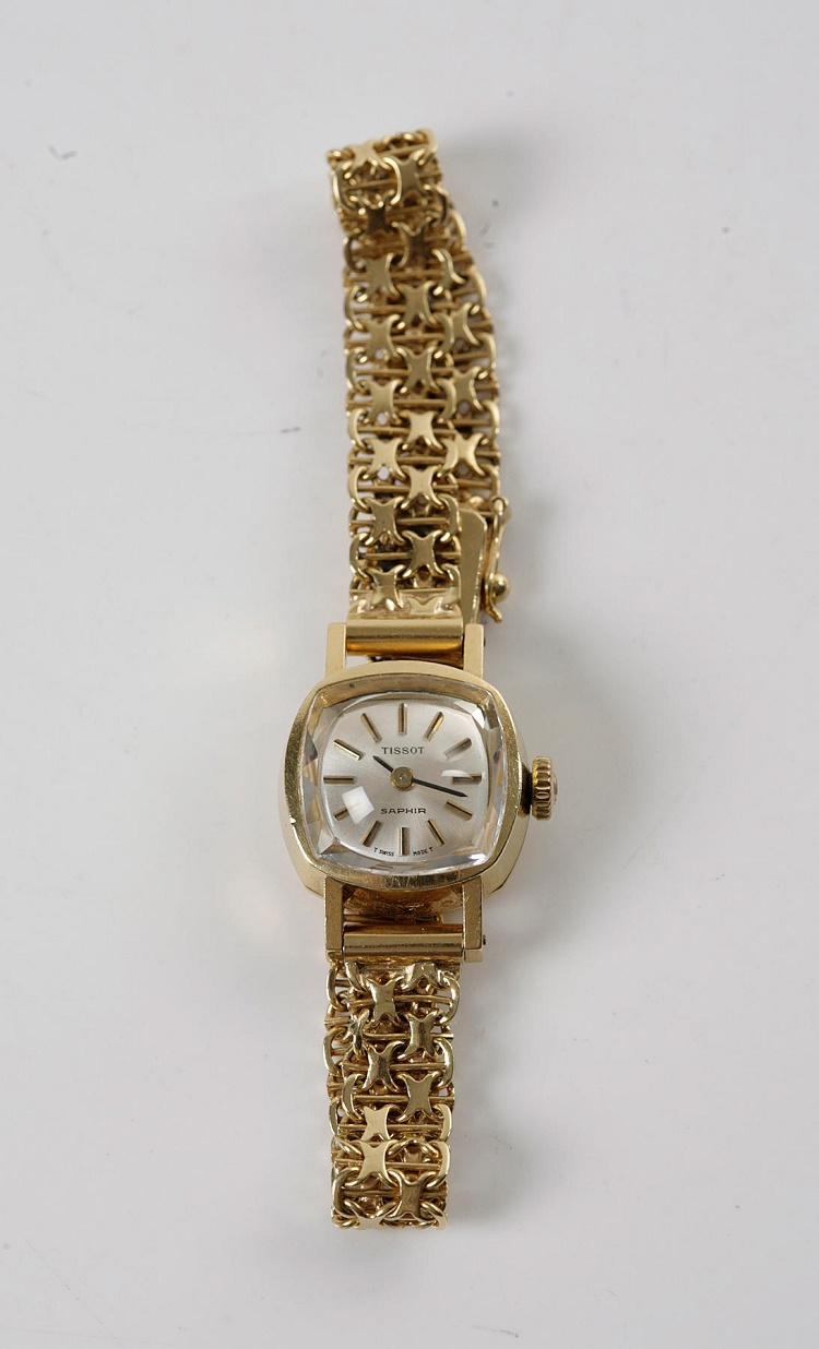 Boett och länk i 18K guld. Tissot Saphir. Vikt ca 21,1 gram. Längd 16,5 cm. Aktuellt bud 3200 SEK.