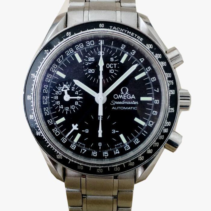 Herrur, Omega Triple Calendar Speedmaster Automatic Chronograph. Utropspris: 19 000 - 25 000 kronor.