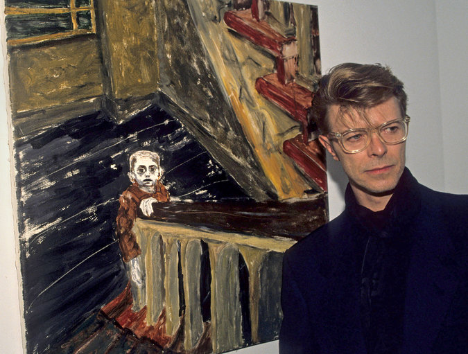 "David Bowie in 1990 with ""Child in Berlin,"" one of his own paintings at a charity event at the Eduard Nakhamkin Fine Arts Gallery, New York City"