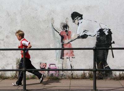 Banksy, Policeman Searching Girl, 2007