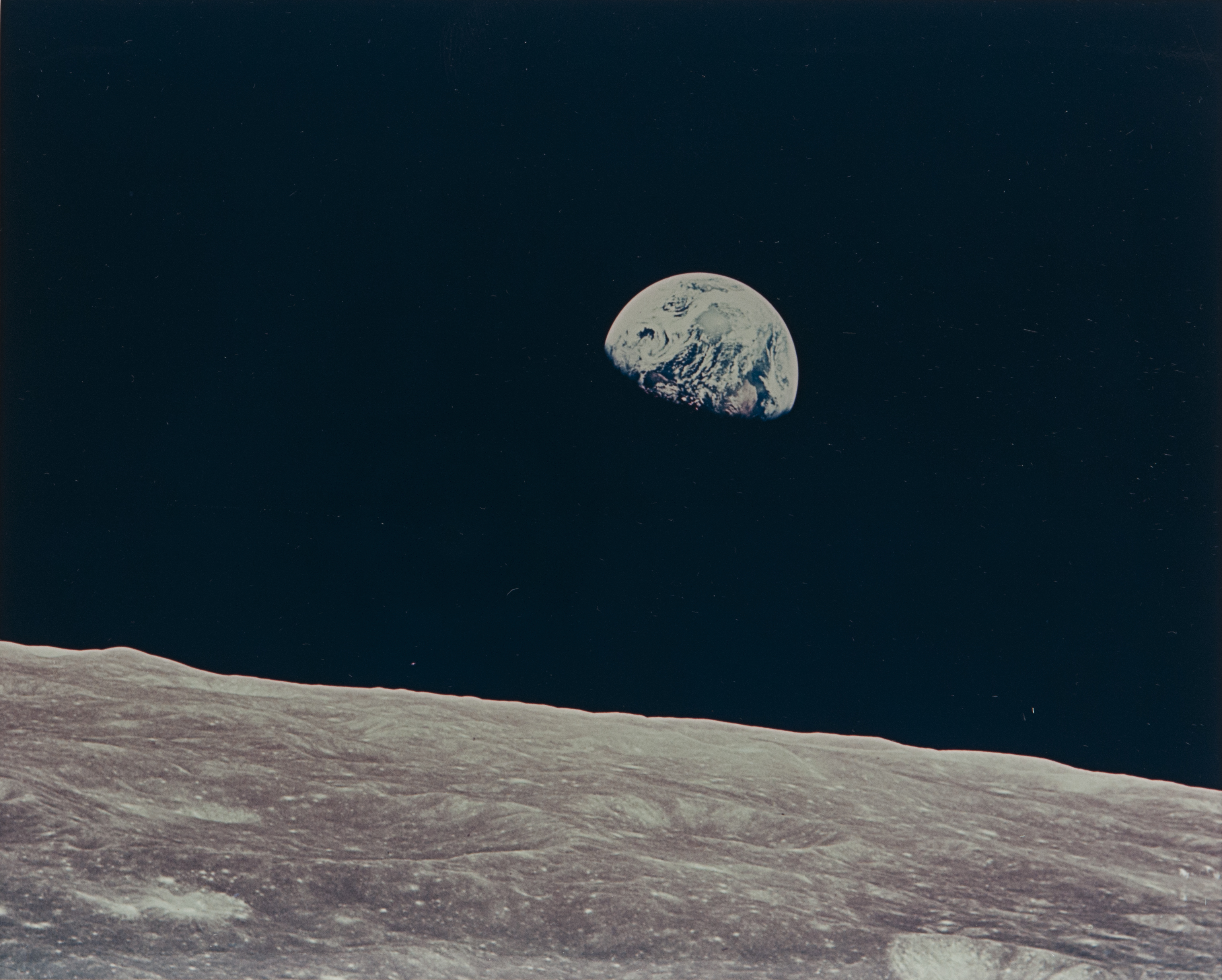 William Anders (American, b. 1933) First Earthrise seen by human eyes, Apollo 8, December 1968. Vintage chromogenic print on fiber-based Kodak paper with a 'A Kodak Paper' watermark on the verso