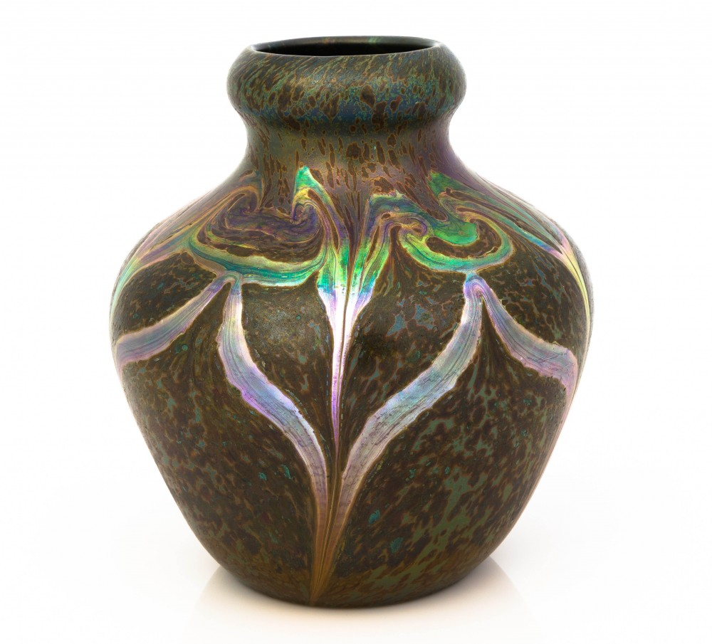 Tiffany Studios (N.Y.) decorated Cypriote vase, circa 1899, 9 inches tall, with the rough surface textures resembling the decomposed surfaces of Roman glass buried for centuries ($36,600).