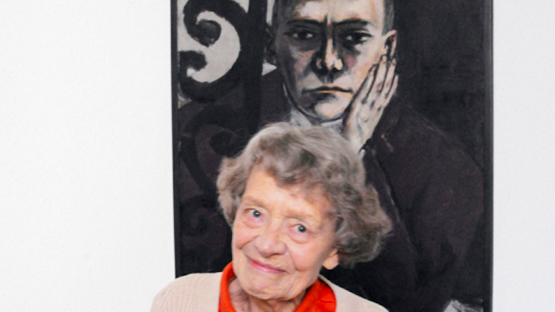 "Barbara Göpel in 2011 infront of Max Beckmann's ""Self-portrait at the bar"". Image courtesy of Grisebach."